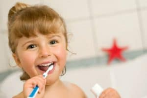 kid brushing teeth a northwest dental doctor eric lee dentist washington